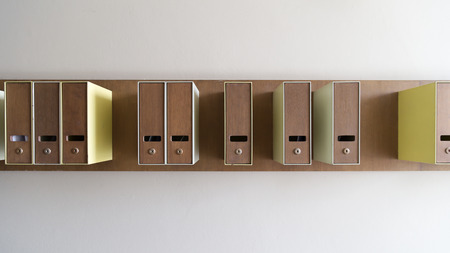 grouping: Mailboxes on the wall are grouping randomly
