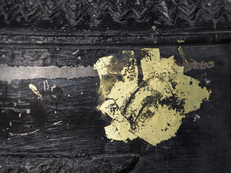 solid color: Tattoo by gold color onto solid iron surface of bell