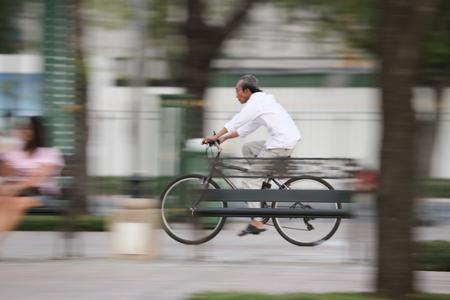 panning shot: Bangkok, Thailand, 1 November 2015: Panning shot on street biker cycling in the public park