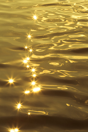 crystalline gold: Colorful star Bokeh from reflection of water sprite with sunlight