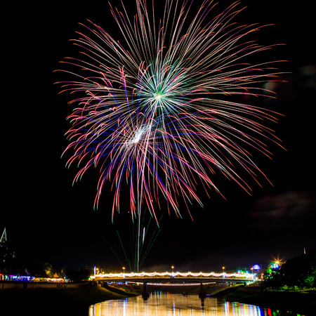 5 december: Colorful fireworks above bridge on celebration day of 5 December 2015 Kings birthday in Thailand