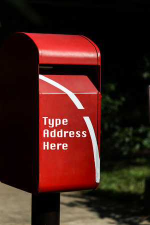 consign: Red mailbox with shade from sunlight which standing in the public park Stock Photo