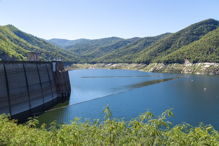 thailand flood: Concrete tall barrier of big dam in Thailand, surround by green mountain