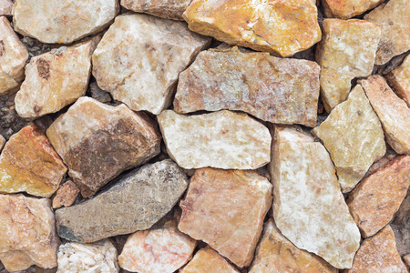 sorted: Background from wall of beach stone sorted in random direction Stock Photo