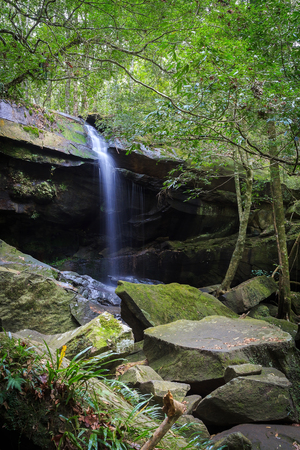 phukradueng: Drought waterfall inside Phukradueng national park in Loei province of Thailand. This waterfall has small amount of water during the winter season. The rock below appear with moss and fern. Stock Photo