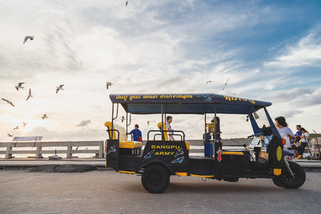 samutprakarn: Samutprakarn, Thailand -  January 15, 2016: Tuktuk or 3-wheel taxi in Thailand. Its 2 seats for passenger behind the driver. It on the bridge at Bangpu, Samutprakarn, popular place for seeing seagulls. Editorial