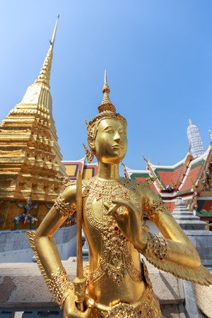 stated: Bangkok, Thailand - March 1, 2016: Gold statue of human half bird which stated inside Wat Phrakaew temple in Bangkok, Thailand.
