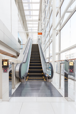 stopped: Stopped short escalator in the white building Stock Photo
