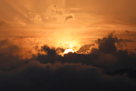 appears: Partial of sun appears from dark cloud in the morning with golden sky