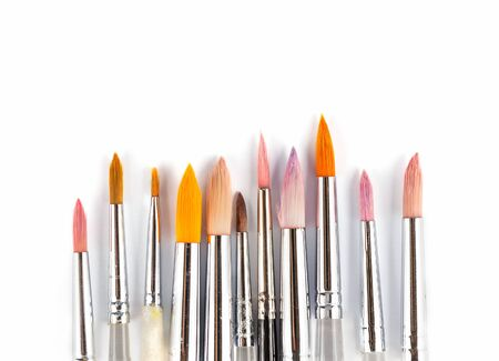 metal filament: Watercolor paintbrushes in different sizes and colors which isolated on white background Stock Photo