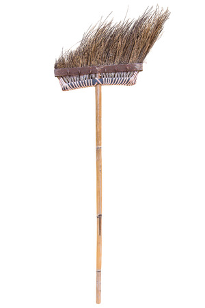 scuff: Old style brown broom which made from dry coconut stalk and bamboo stick isolated on white background
