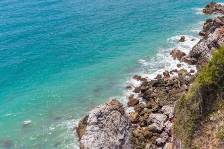 seaboard: Aerial view on rock coast with wave from deep blue sea in Kho Kham island in Suttahip of Chonburi, Thailand Stock Photo
