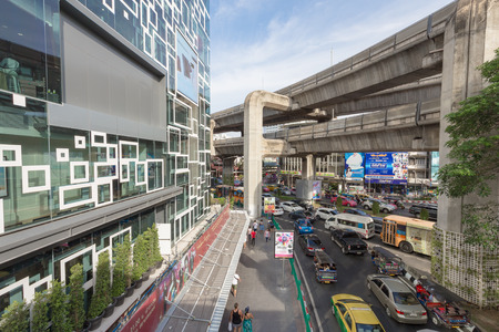 rail cross: Bangkok, Thailand - May 29, 2016: Traffic outside the new mall called Siam Discovery in Bangkok city. The sky train rail cross beside. This place is crowded day and night. Editorial