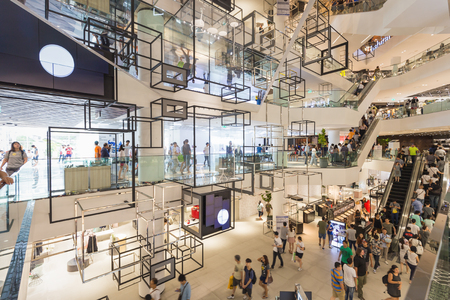 Bangkok, Thailand - May 29, 2016: Inside new renovated shopping center called 'Siam Discovery' in Bangkok. There was crowded walking around. This place decorated in modern style.