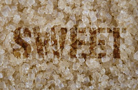screened: Sweet word screened on background of close focus brown cane sugar