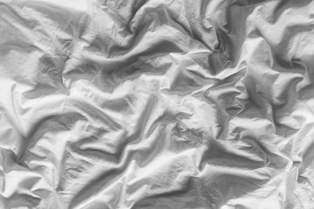 bedcover: Close up on black and white tone color background of white wrinkled cotton blanket