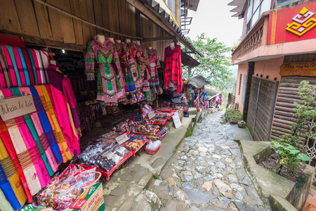 pa: Sa Pa, Vietnam - September 18, 2016: Walkway surrounded by local shops sell a local gift and souvenir in Cat Cat village of Sa Pa, Vietnam. Editorial