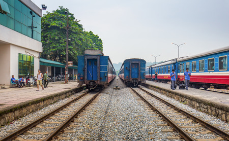 Lao Cai, Vietnam - September 18, 2016: In front of Ga Lao Cai railway station in north of Vietnam. People walk around after train arrived in morning.