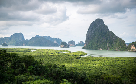 humid: Panorama view of island inside sea near green beach called Samet Nangshe which is attractive place in Phang Nga of Thailand. Stock Photo