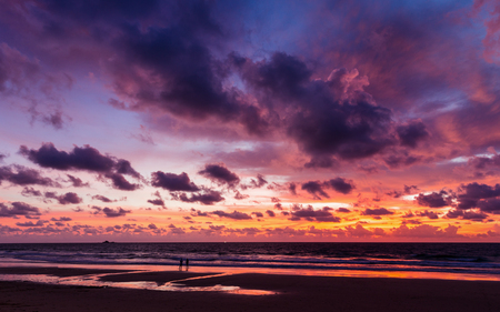 Colorful cloudy sunset sky of twilight at beach of Phuket, Thailand. Dark clouds floating before rain storm coming at night. Stock Photo