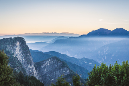 Scenic view of mountain range covered by fog in morning before sunrise at Zhushan, Alishan Recreation Area of Taiwan.