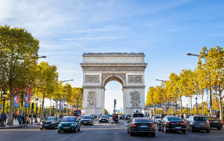 Paris, France - September 29, 2018: Pedestrian view on traffic road of Champs-Elysess to Arc de Triomphe, built to honour the victories of Napoleon Bonaparte.