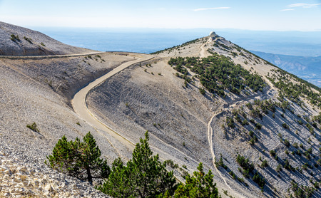 Top of rock mountain Mont Serein Ventoux with curve road on edge of hill in Provence, France. Banco de Imagens