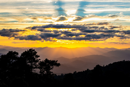 Hazy mountain range of Huay Nam Dung national park, Chiangmai, Thailand with sunset sky. Stock Photo