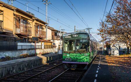 Kyoto, Japan - November 20, 2018: Arriving train of Keifuku Electric Railroad Kitano Line arriving Ryoanji station. Editorial