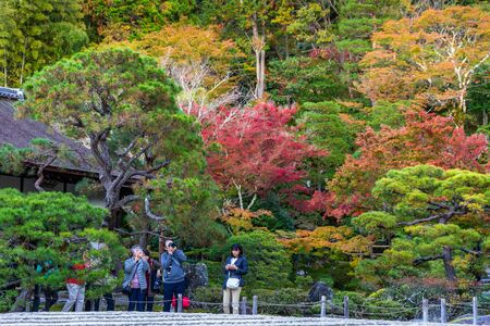 Kyoto, Japan - November 19, 2018: Tourist taking photo in colorful park, tree change color during autumn and winter. Editorial
