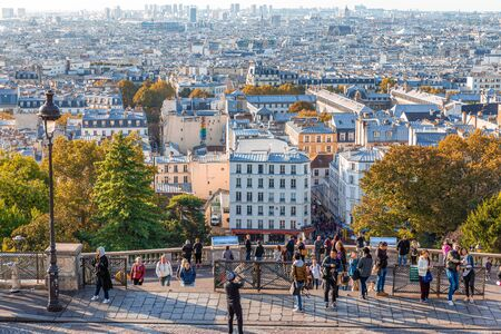 Paris, France - September 29, 2018: City of Paris in morning from aerial view on hill of Basilica du Sacre-Coeur de Montmartre.