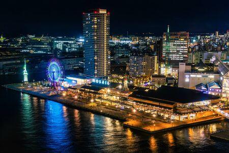 Kobe, Japan - November 22, 2018: Aerial view of Kobe Harborland and Mosaic garden at night. Editorial