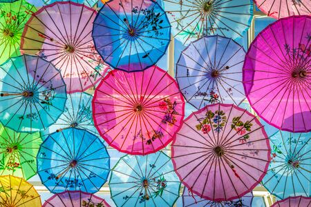Decoration on wall by plenty sizes of colorful umbrella.