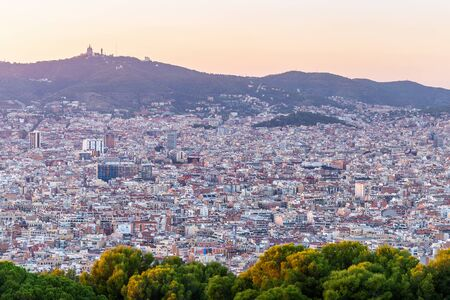 Aerial scene of Barcelona, Spain in panorama view at sunset.