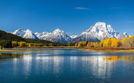Mount Moran view from Oxbow Bend beside Snake River of Grand Teton, Wyoming. Color of tees and environment changing due to autumn change to winter.