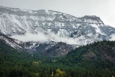 Snowcapped canyon mountain range inside Yellowstone National Park, Wyoming, USA in early winter season.
