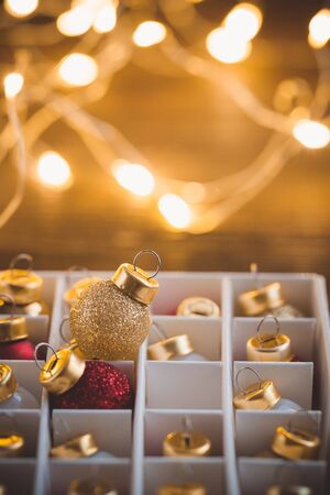 Unpacking Christmas balls toys with glittering garland. Toned