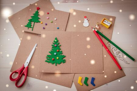 Signing Handmade Christmas cards Felt scissors buttons Christmas-tree scrapping.