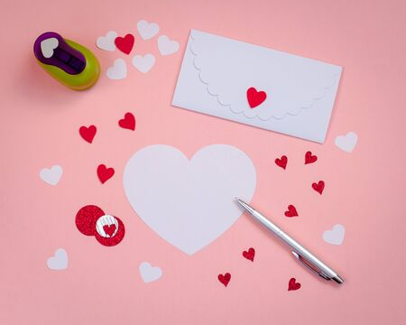 Signing Handmade Valentine cards with Felt, silver pen. white envelope. Toned.