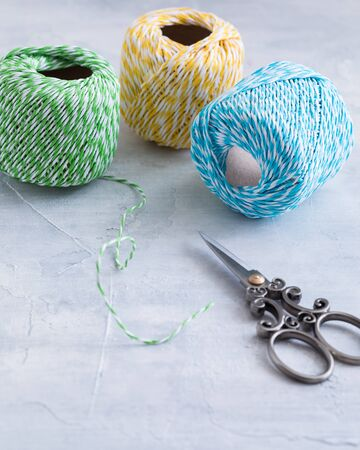 Colored cords with scissors, present wrapping and packing material, with a copyspace