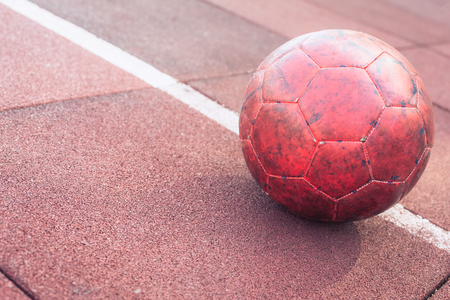 An old soccer ball on the sportsground, toned vintage 스톡 콘텐츠