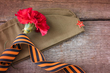 The George ribbon on the field cap, 9 may Victory Day postcard concept, toned