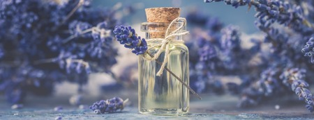 Bottle of natural cosmetic lavender oil, hair and body treatment, toned vintage 写真素材 - 104024919