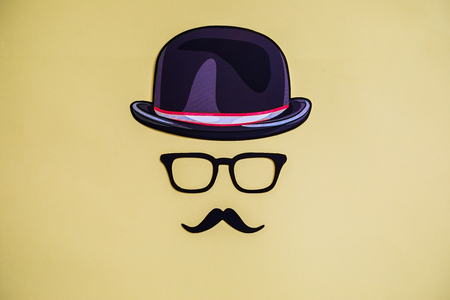 Happy Movember with Copy Space. Moustache photo booth props, yellow background