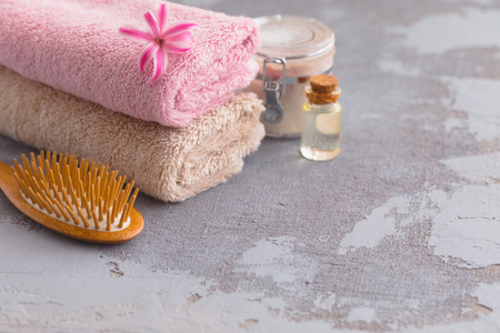 Spa body care oil and creme products with organic bamboo hair brush and towels, toned