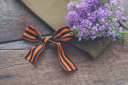 St. George ribbon on old wooden background, symbol of Victory Day May 9, toned 스톡 콘텐츠