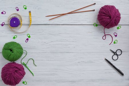 Background with knitting tools and accessories, colorful skein yarn, hobby concept, copyspace, top view