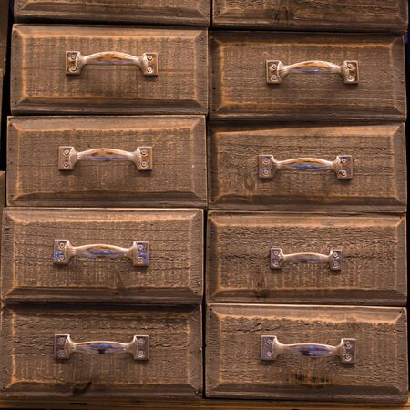 Vintage brown colored and toned wooden drawers background 免版税图像