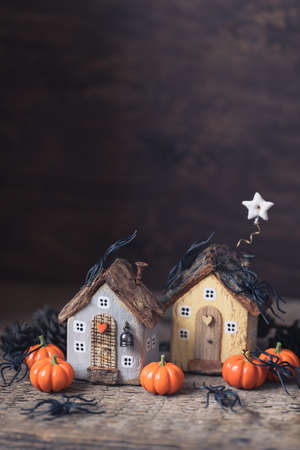 Miniature Halloween Day little fairy autumn cottages, pumpkins, spiders, moss background