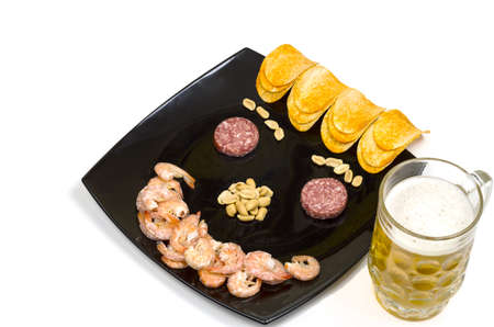 cuisine entertainment: Beer snack Smile shrimp, potatoes and sausage Stock Photo